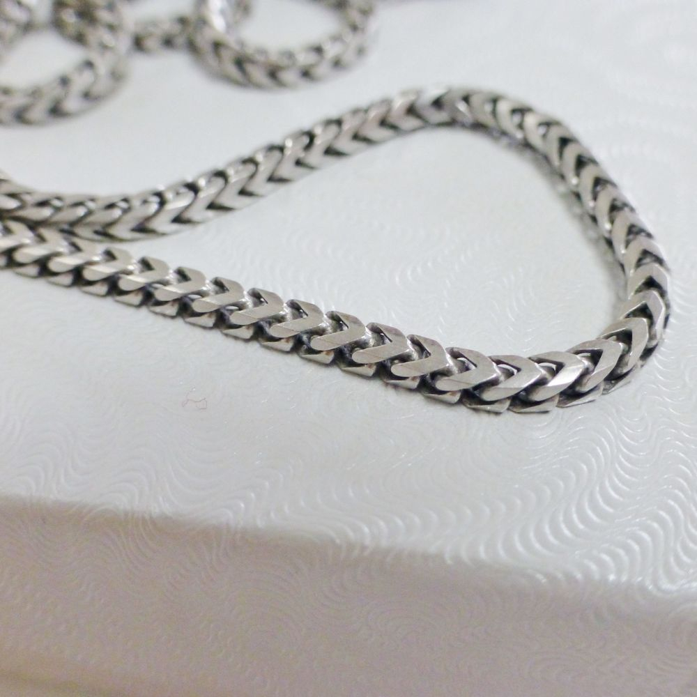 close up picture of a sterling silver men's foxtail link chain