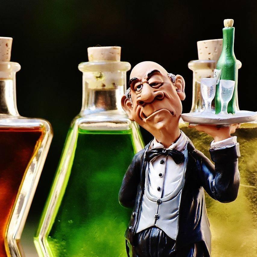 Bartender serving drinks.