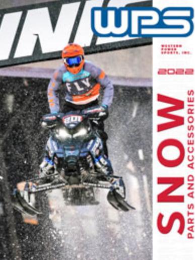 Snocross racer jumping snowmobile
