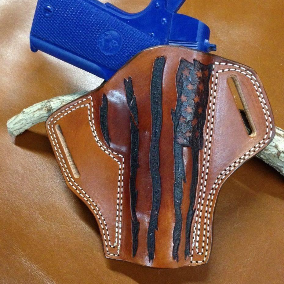 custom gun holsters , pancake style holsters , glock holsters , 1911 holsters , tooled holsters