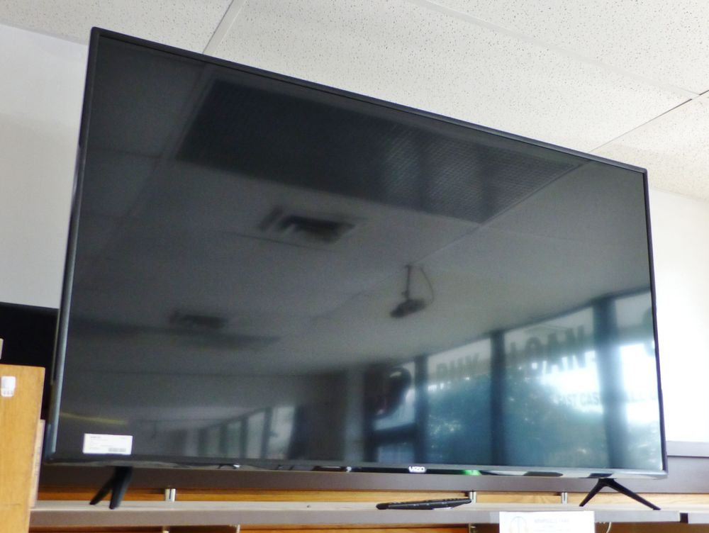 picture of a flat screen tv sitting on top of a shelf