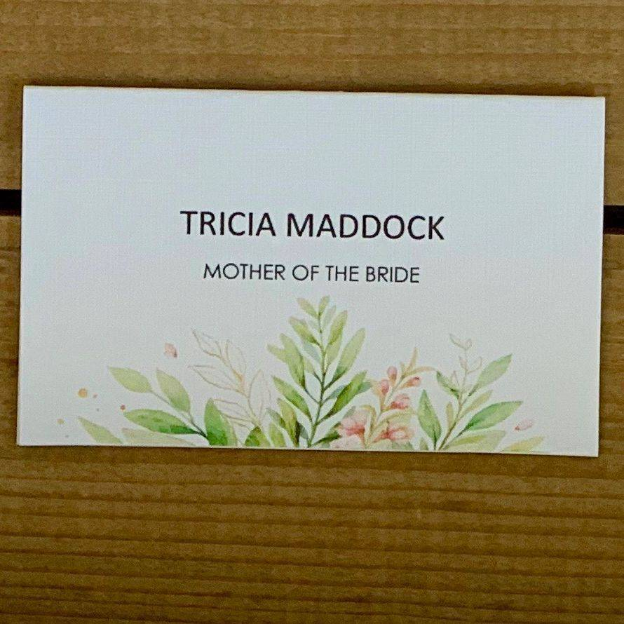 Wedding guest place name - Green foliage with pink flower