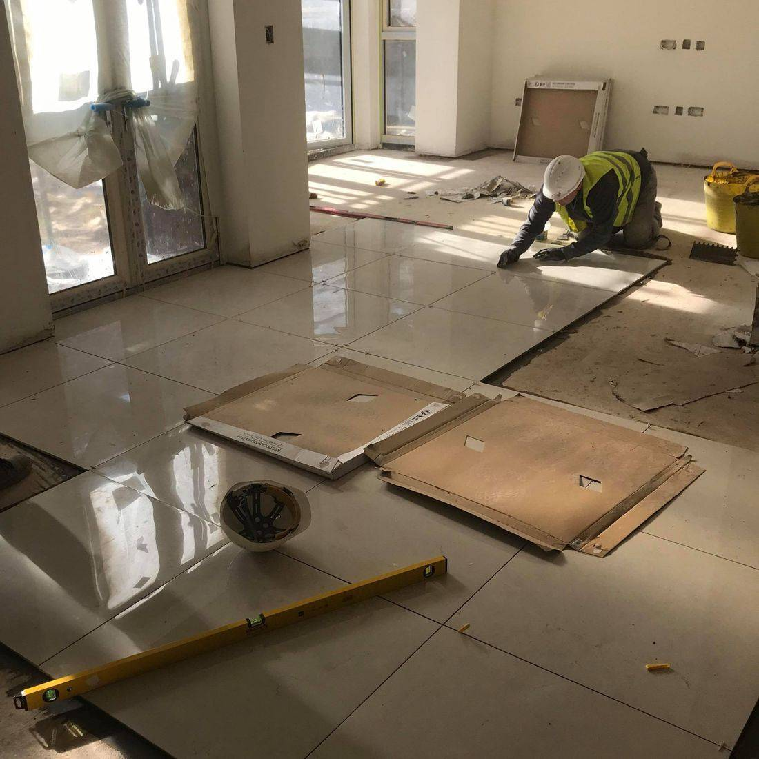 Floor tiling in progress