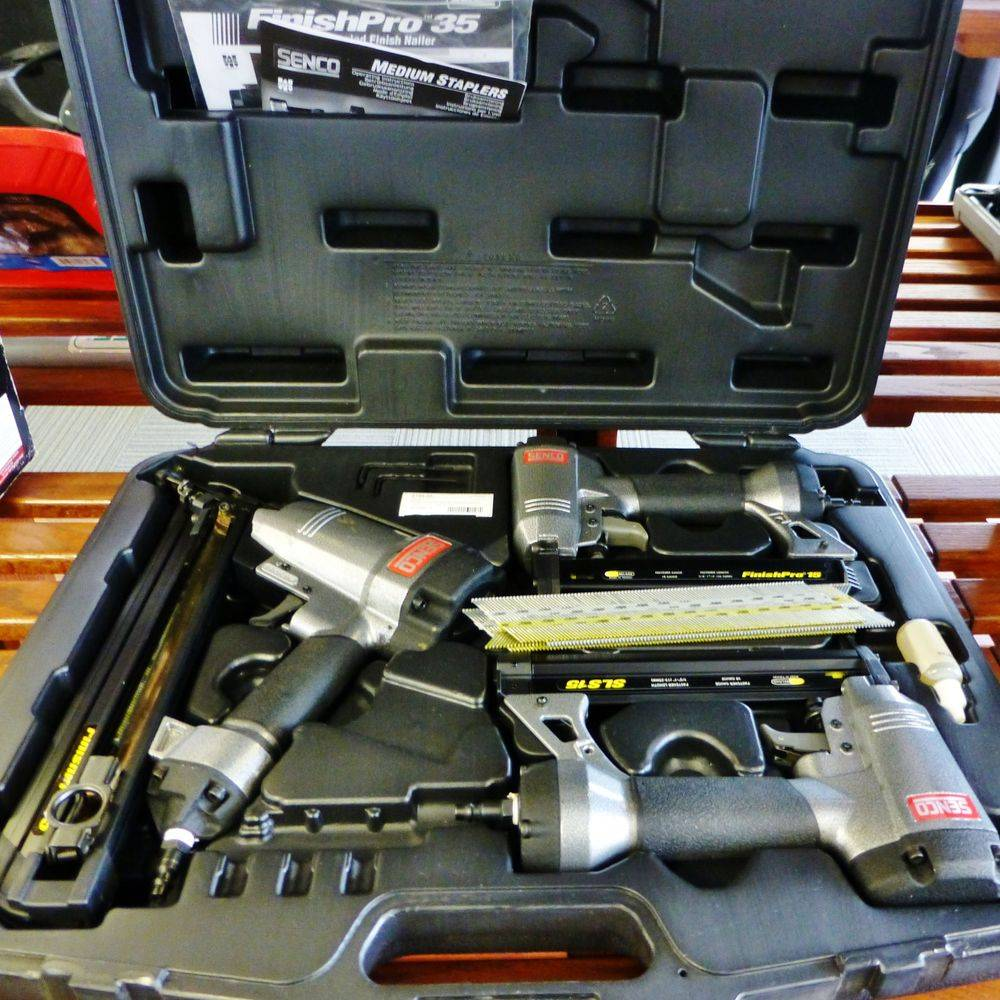 three finishing nail guns in a case on a shelf