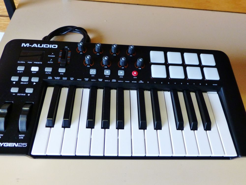close up picture of an M-Audio Midi Keyboard controller on a shelf