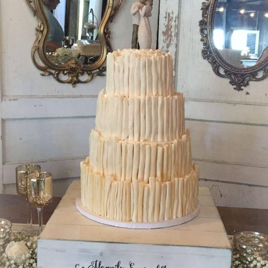 buttercream wedding cake with white chocolate curls modern cake