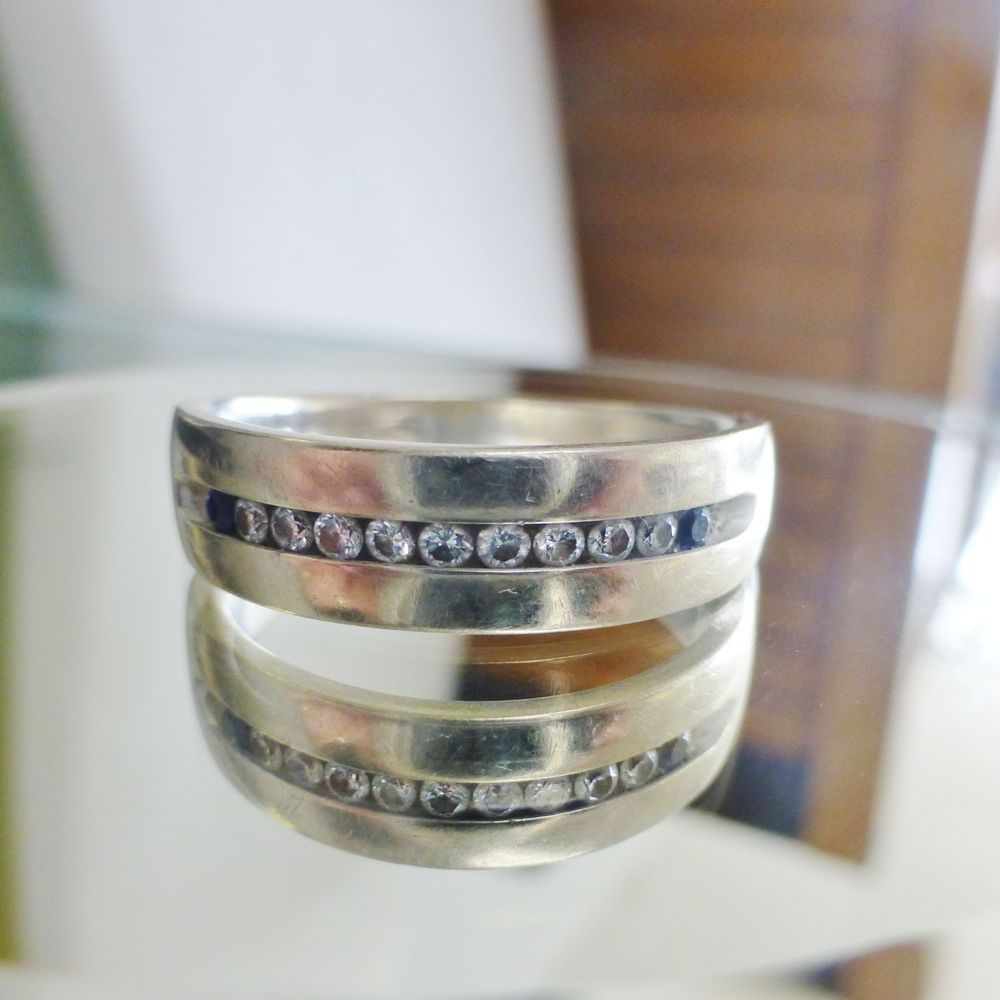close up picture of a Vera Want Love Collection Diamond and Blue Sapphire White Gold Mens Wedding Band