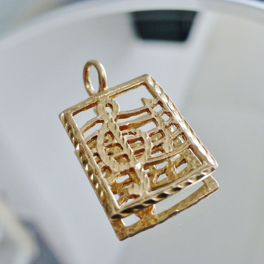 yellow gold rectangle charm with trebel clef and musical notes