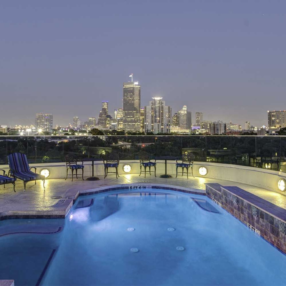 City views at this night lit pool in sought after Memorial  Park in Houston