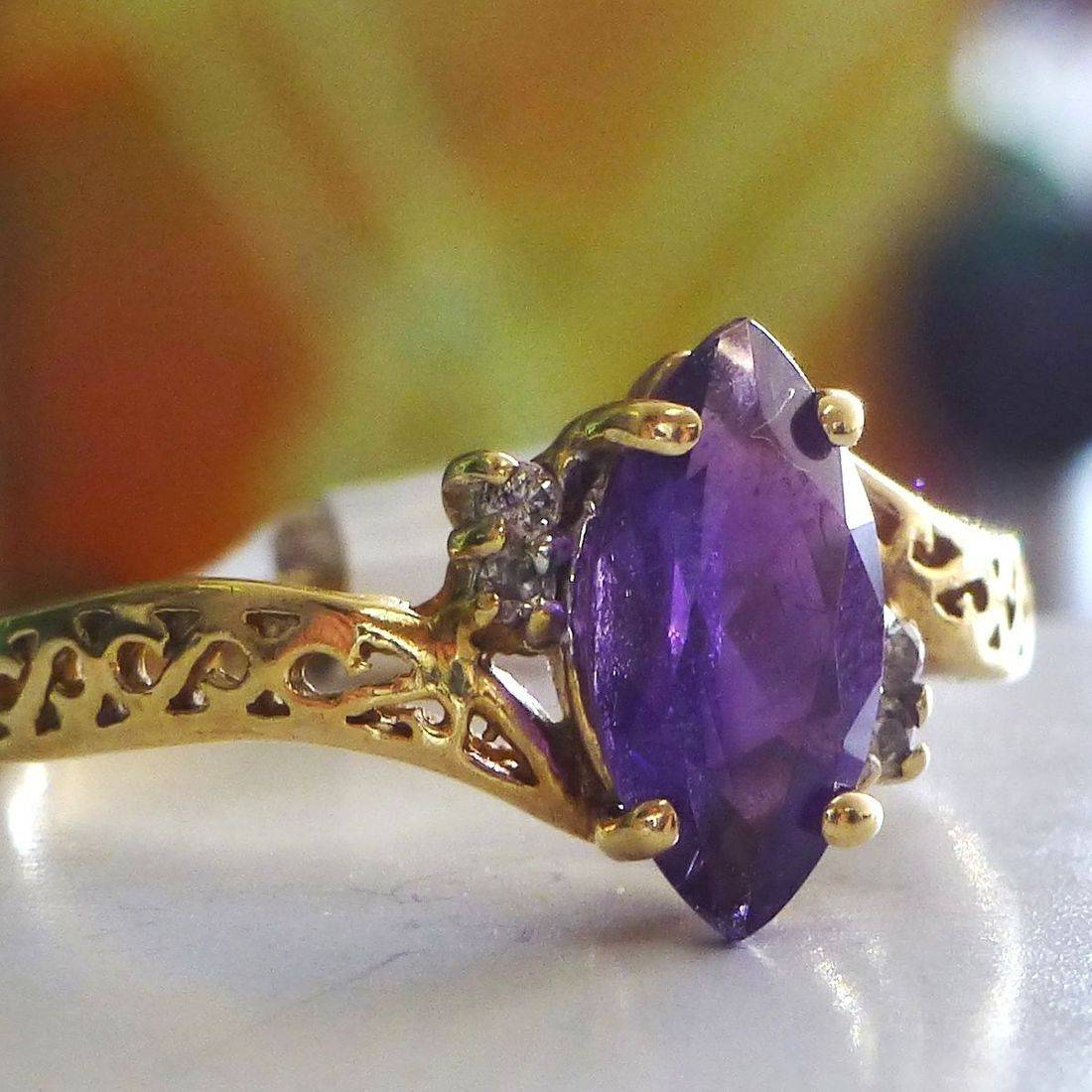 Yellow Gold Filigree Ring With Round Diamond Side Stones  And A Purple Amethyst Marquise Center Stone