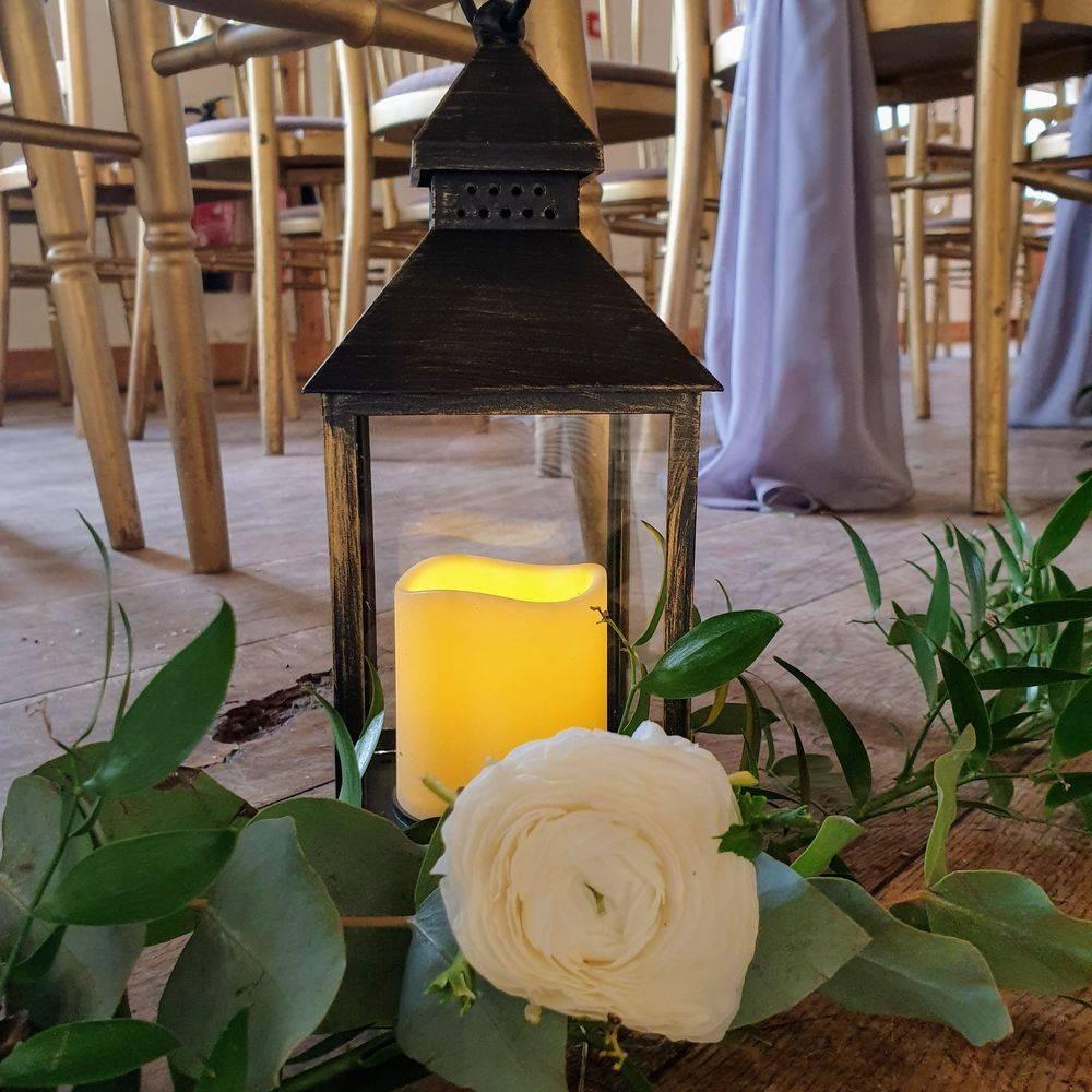 Aisle decor at Burley Manor Barn Weddings