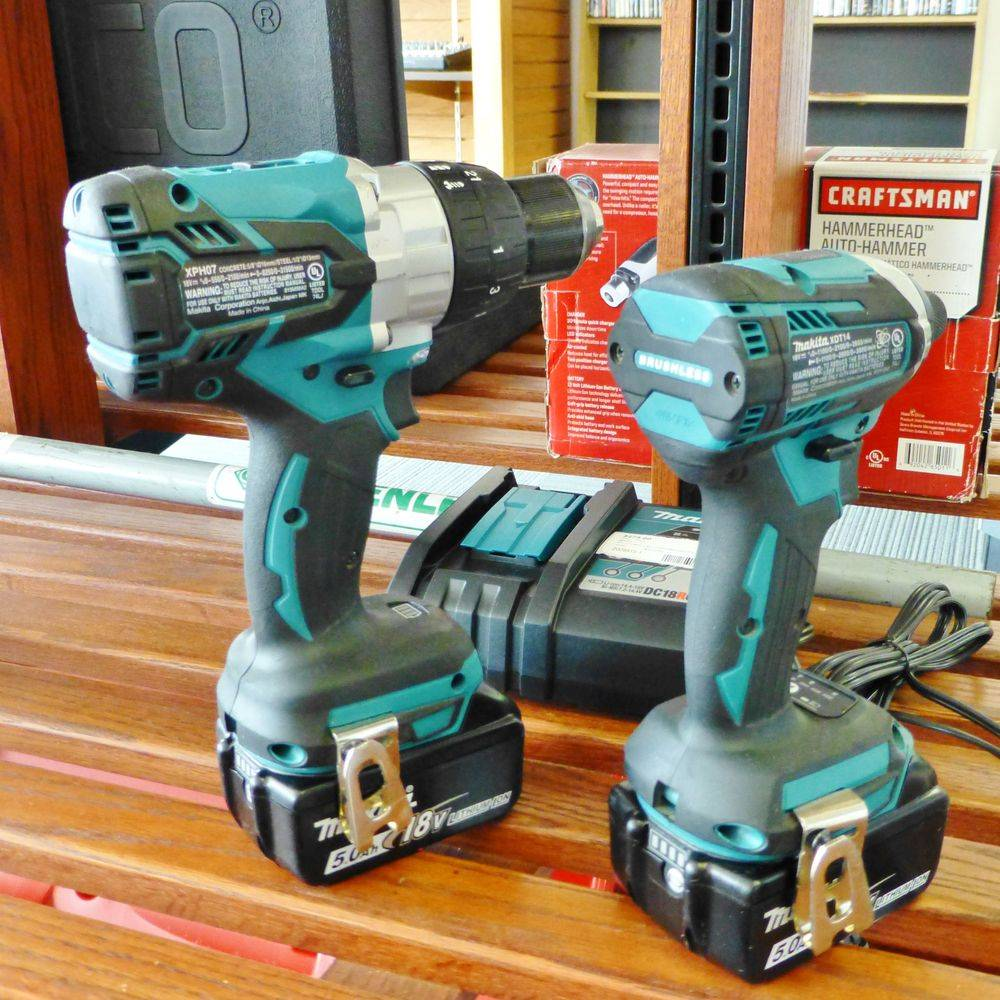 Makita two tool drill combo kit on a wooden shelf