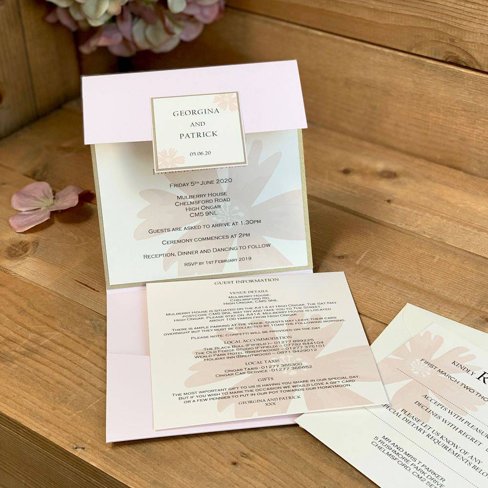 Pale pink and ivory wedding invitation with pocket