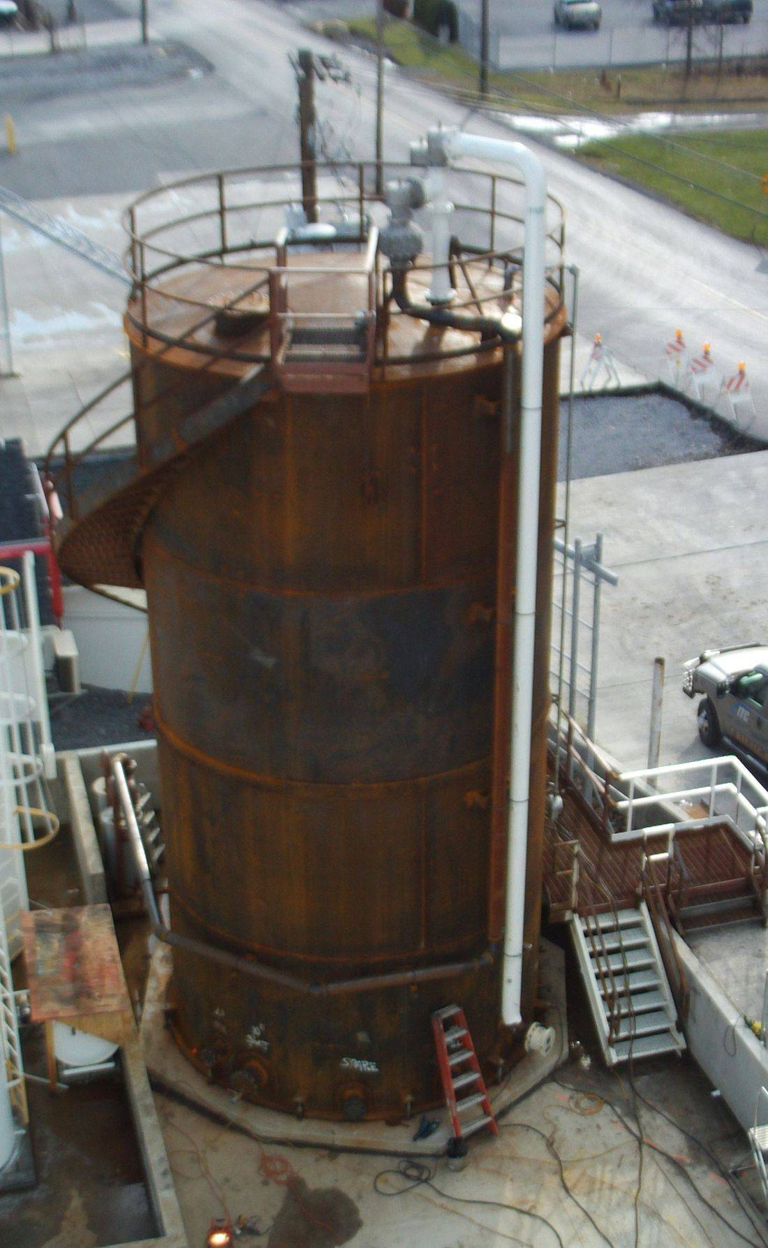 RT sets a storage tank ring during new welded steel storage tank construction.
