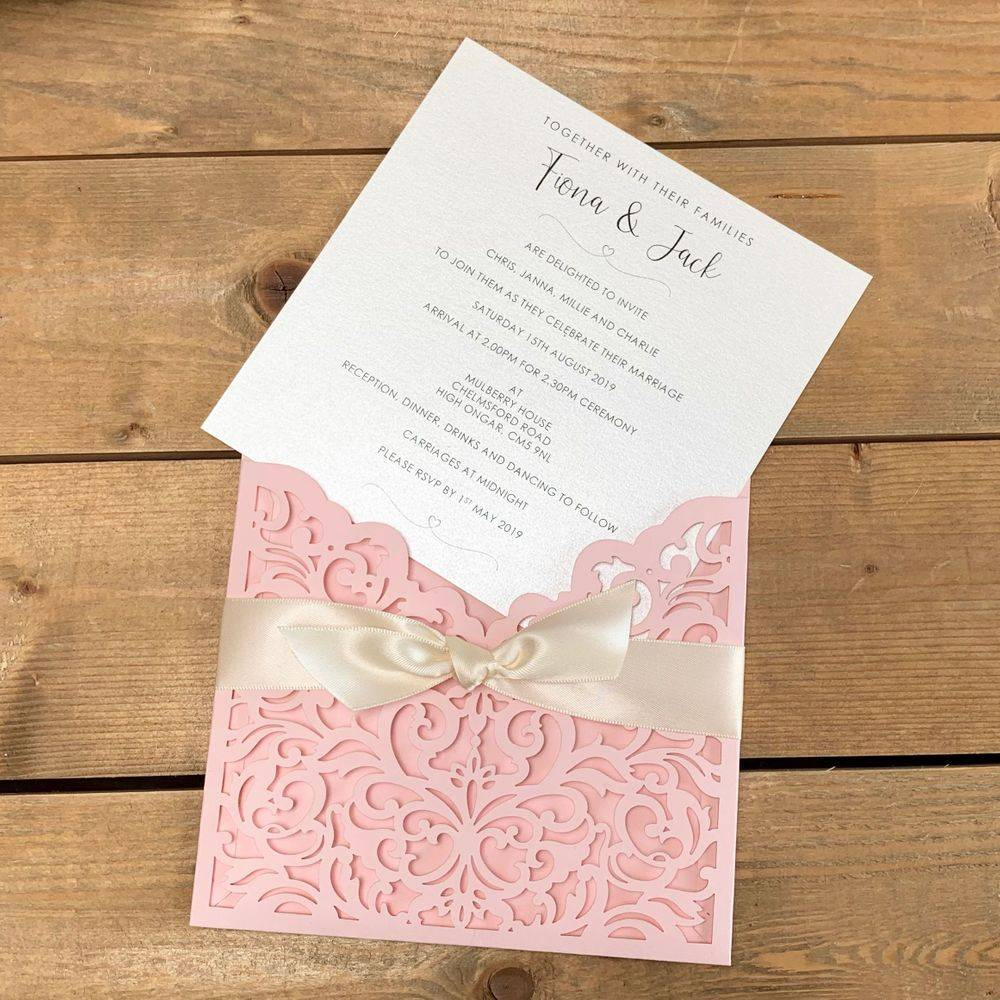Laser cut wedding invitations in pink and ivory
