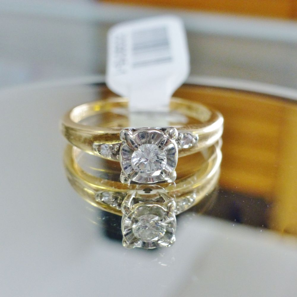 Round cut illusion set vintage diamond engagement ring in yellow gold