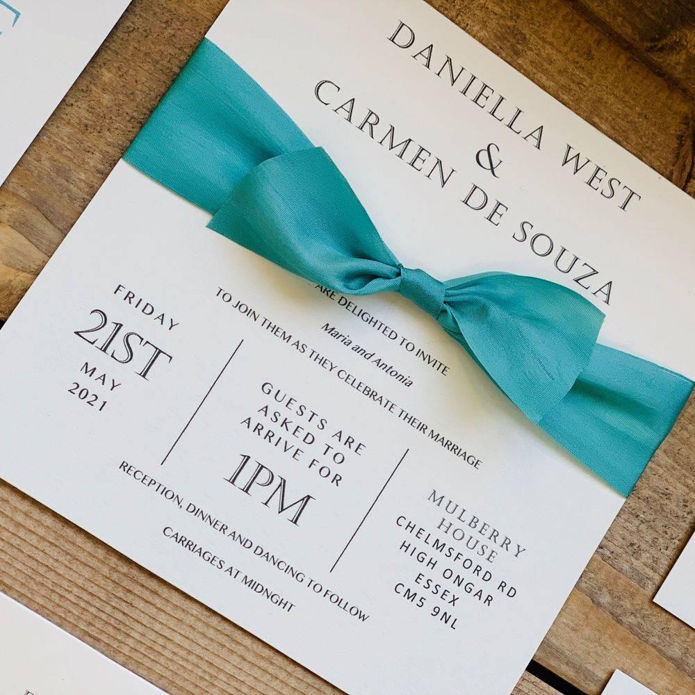 Ivory wedding invitation with Teal silk ribbon