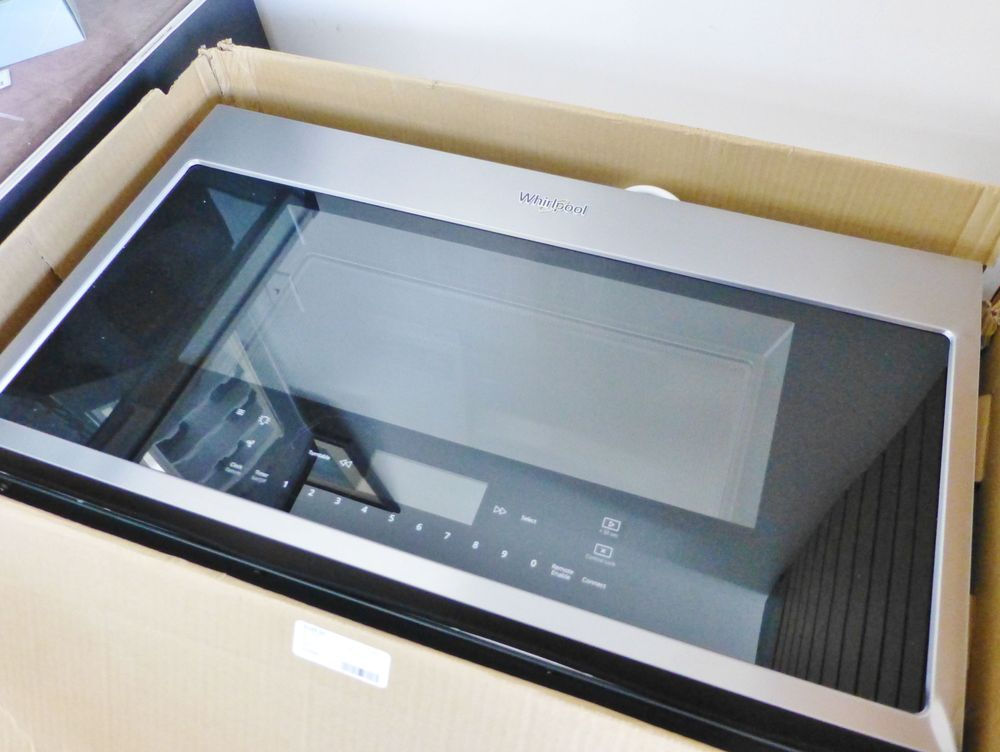close up picture stainless steel microwave in a box