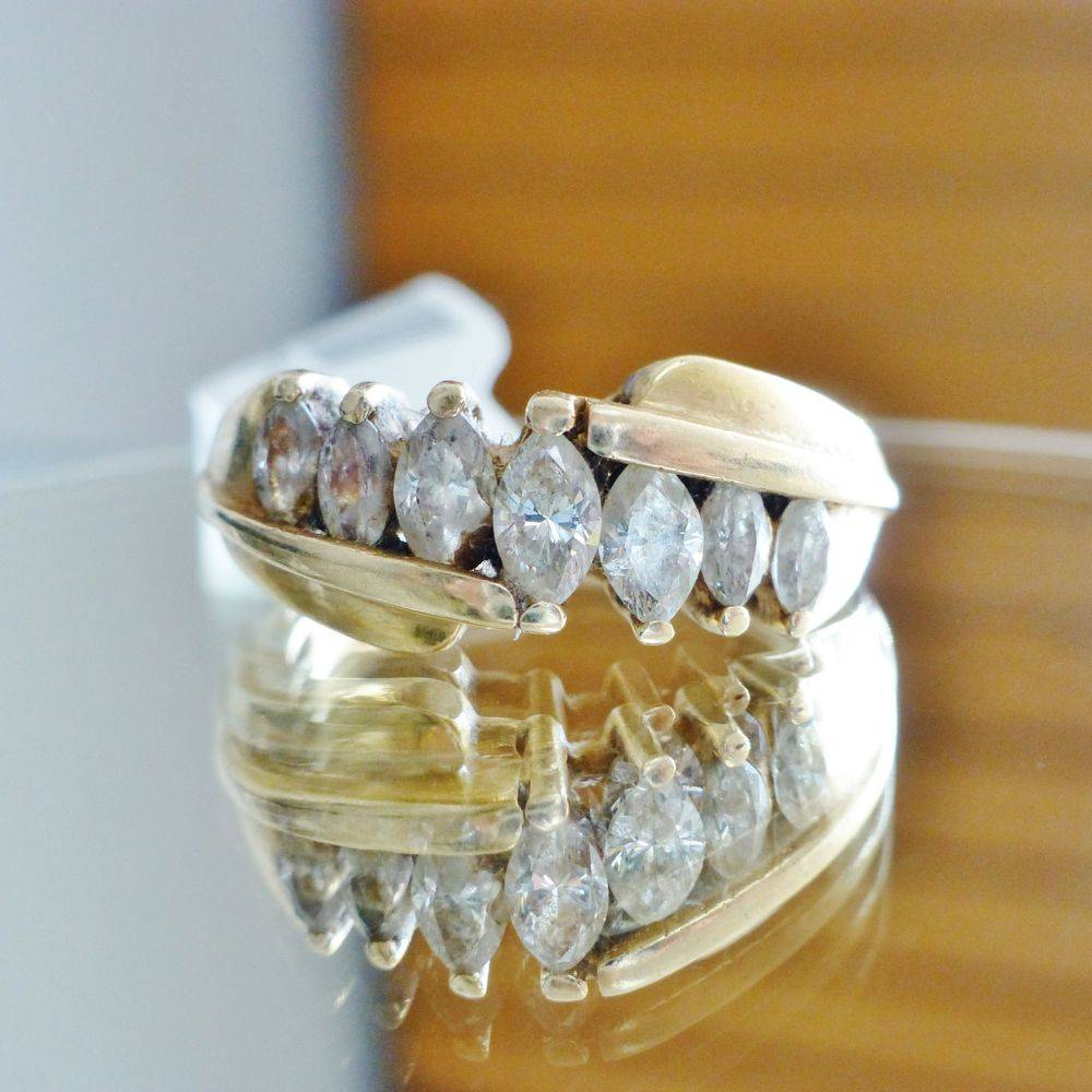 yellow gold ladies wedding band with marquise cut diamonds