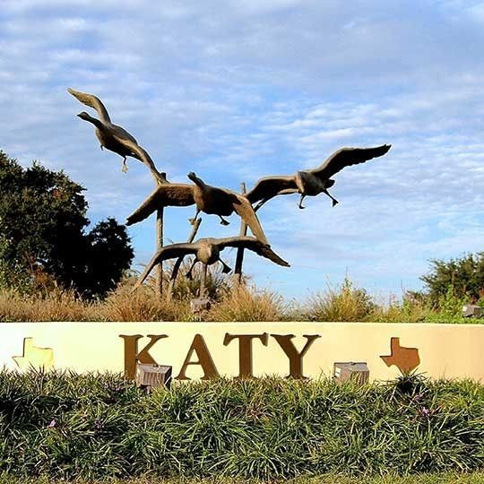 City of Katy sign, apartments in Cinco Ranch and Katy