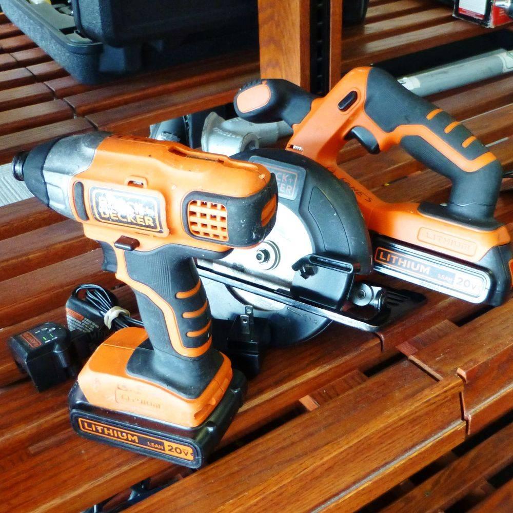 orange and black Black & Decker drill and saw on a shelf