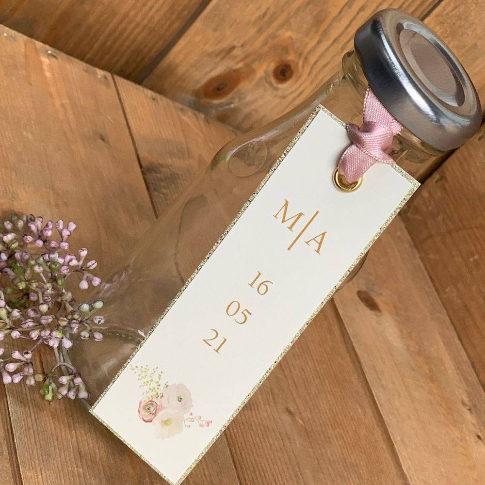 Wedding Favour tags - Printed with initials of bridal couple  and date of wedding. Punched with gold rivet and decorated with rose ribbon
