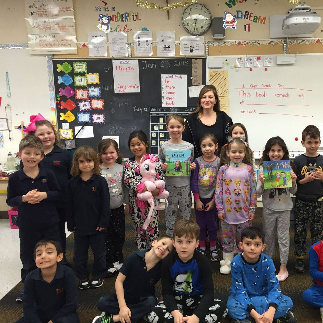 Snuggle Up and Read Day January 29, 2018 St. Clare of Assisi CES Author Daniella Grsic with grade 1 students with books Lucky Stars and Deep Down Inside