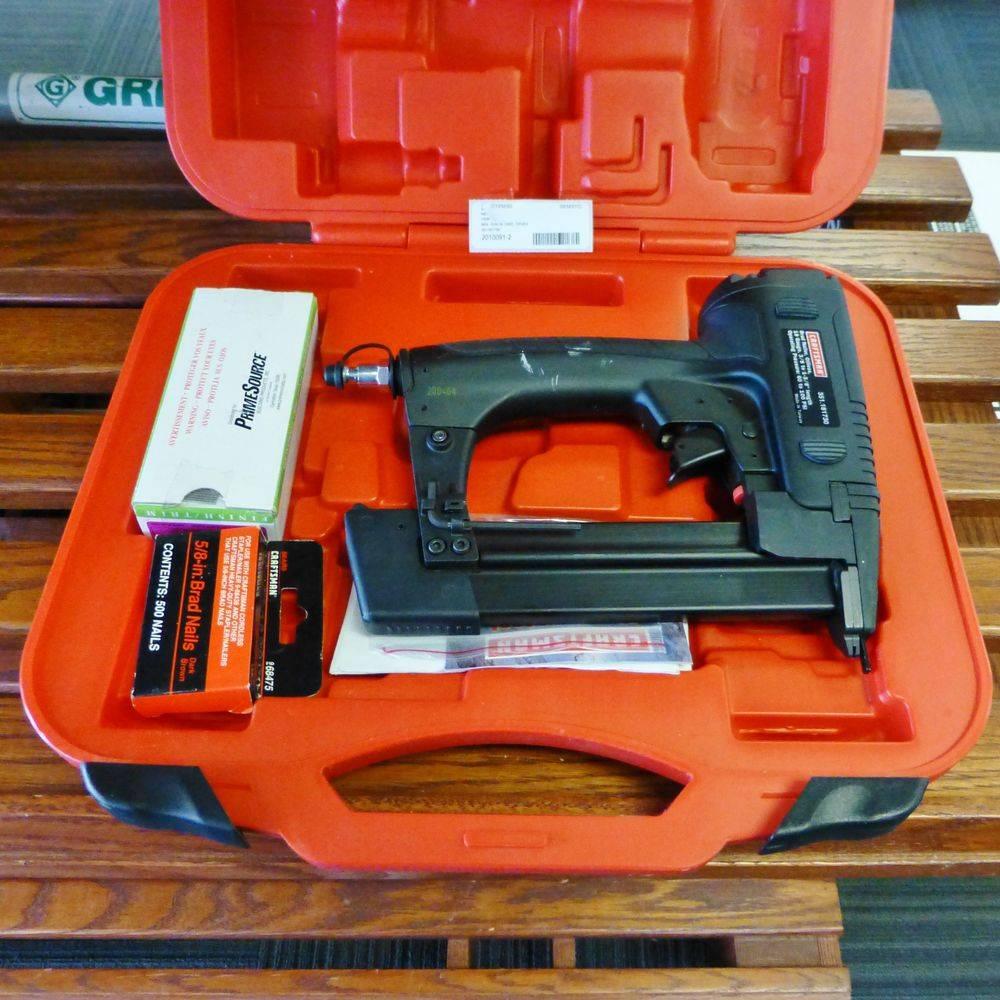 black nail gun in a red hard case