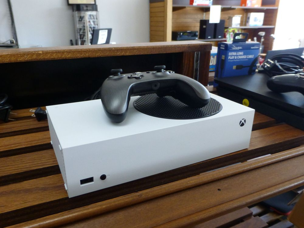 close up picture of a white Microsoft Xbox Series S Game System