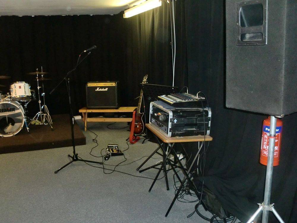 Music Studio Rehearsal Room with drums and guitar