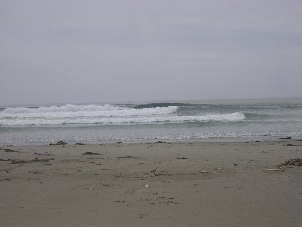 Remote beach surfing on West side of Vargas Island, 1.5 meter swell.