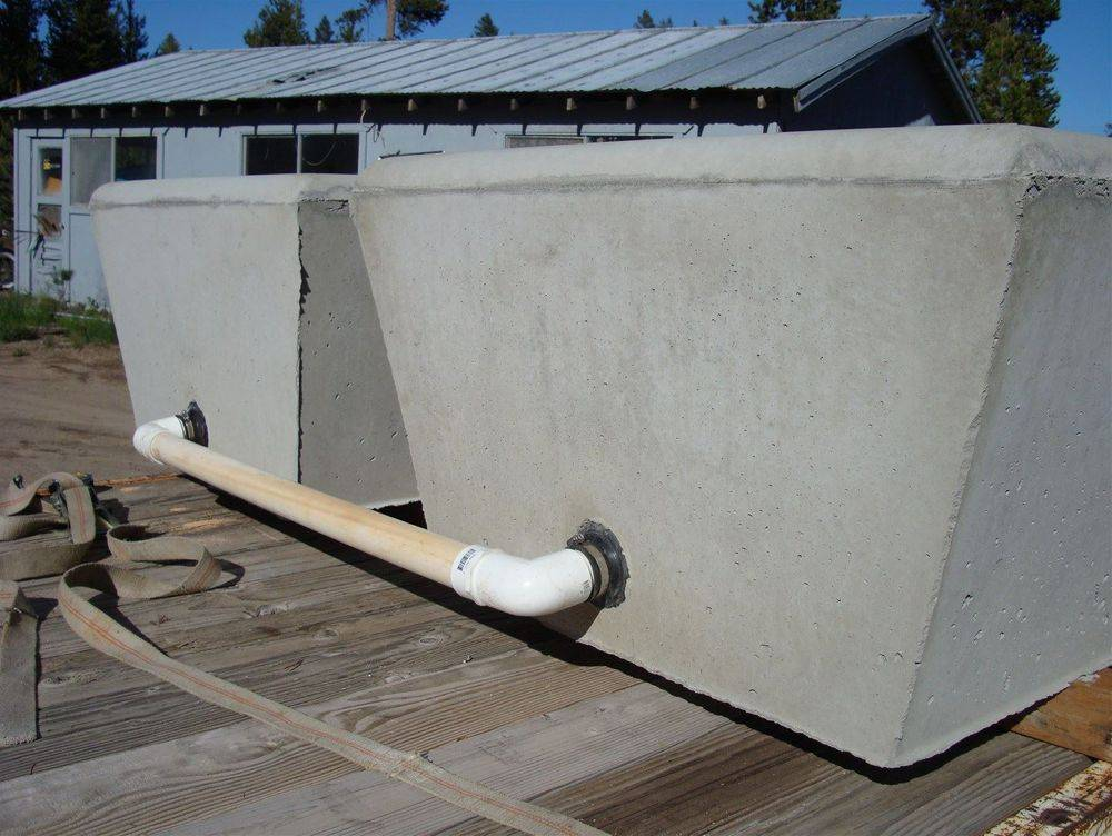 Two Concrete Water Troughs Plumbed together.