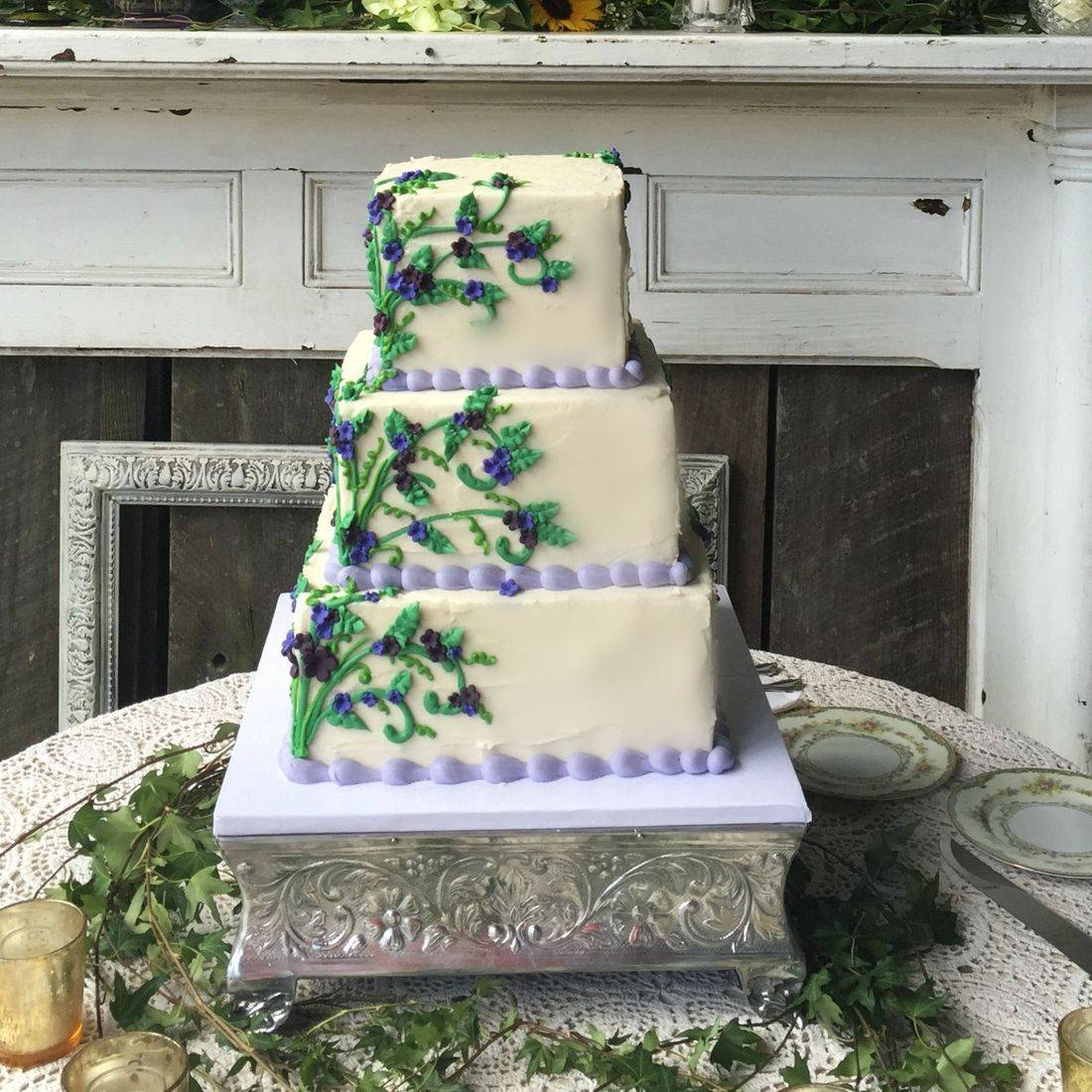 square wedding cake square buttercream cake purple flowers green and lavender