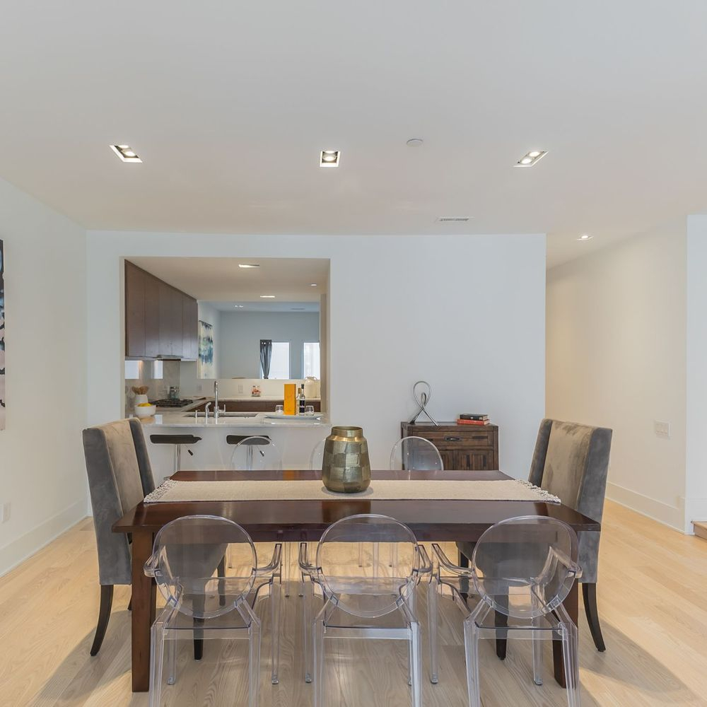 Modern Open Floor Dining Room with Kitchen Serving Hatch