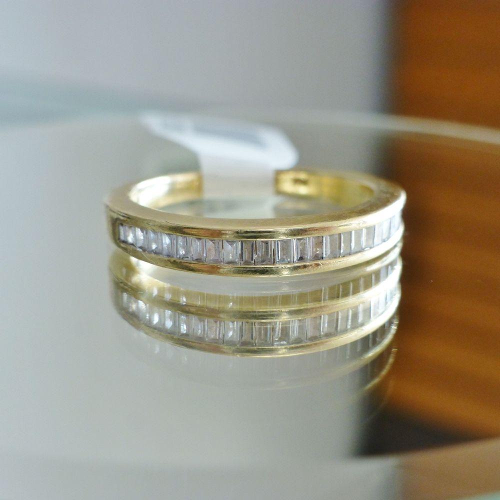 yellow gold baguette cubic zirconia wedding band