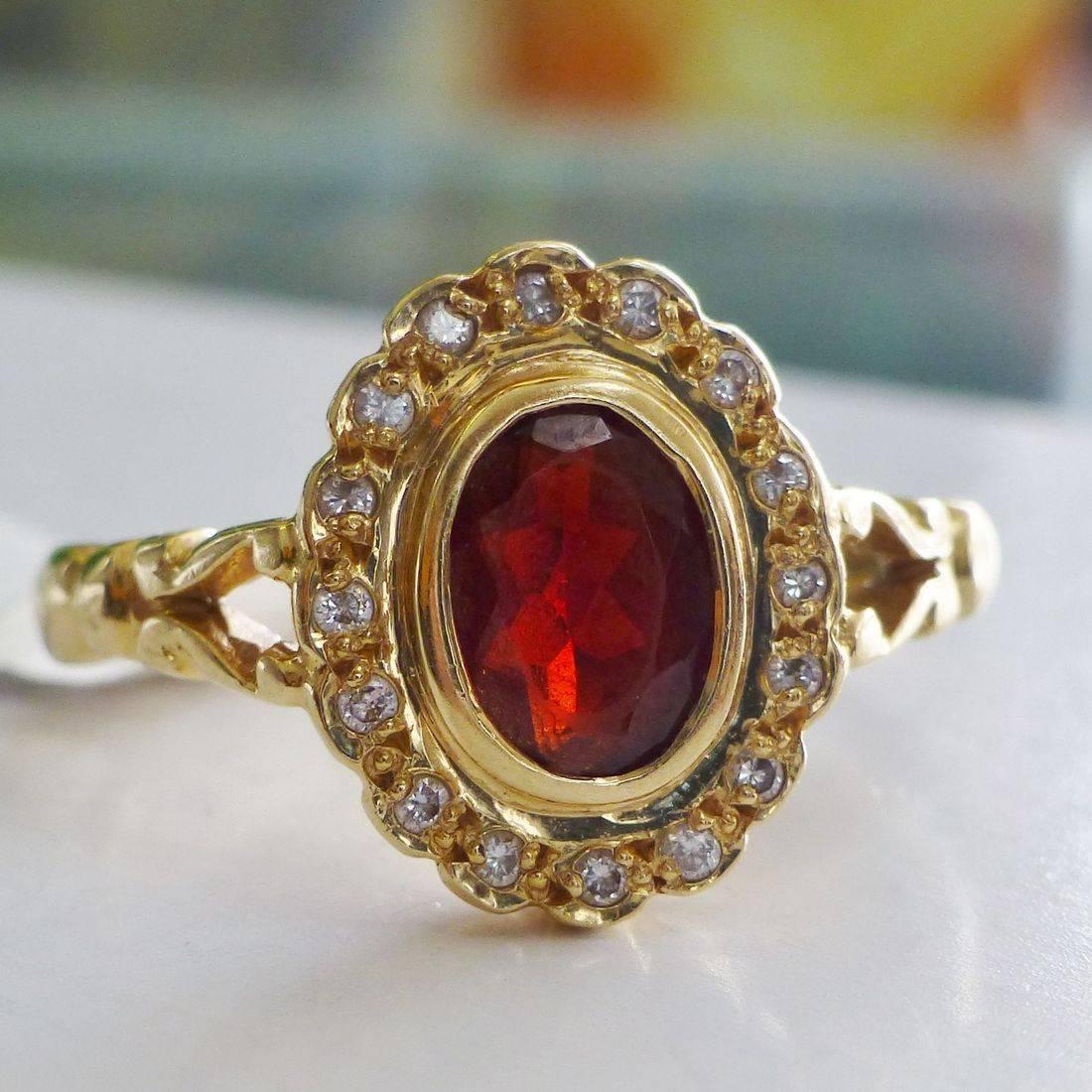 Oval Red Garnet Gemstone Framed in a Round Diamond Halo in 14K Yellow Gold