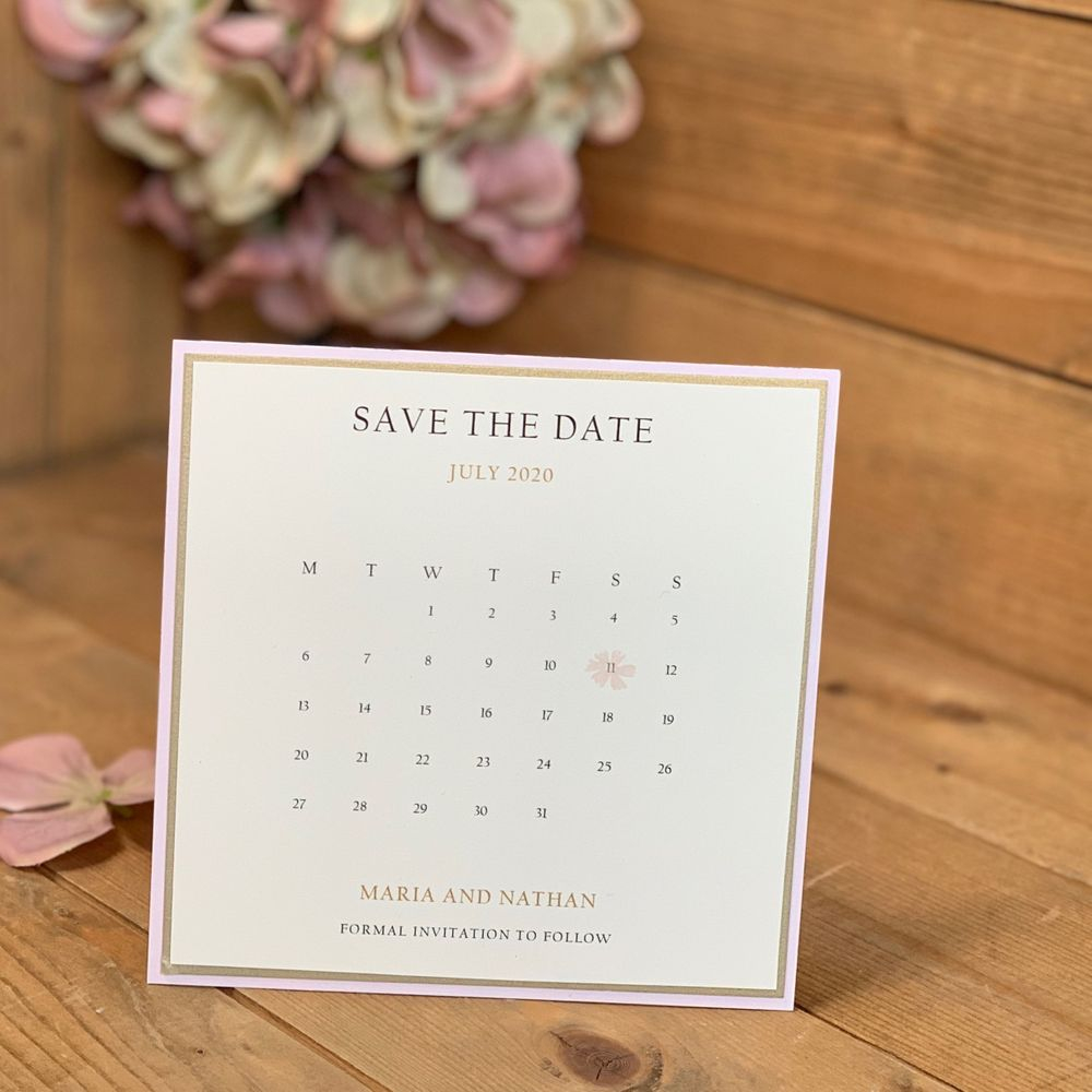 Pink and ivory save the date with calendar