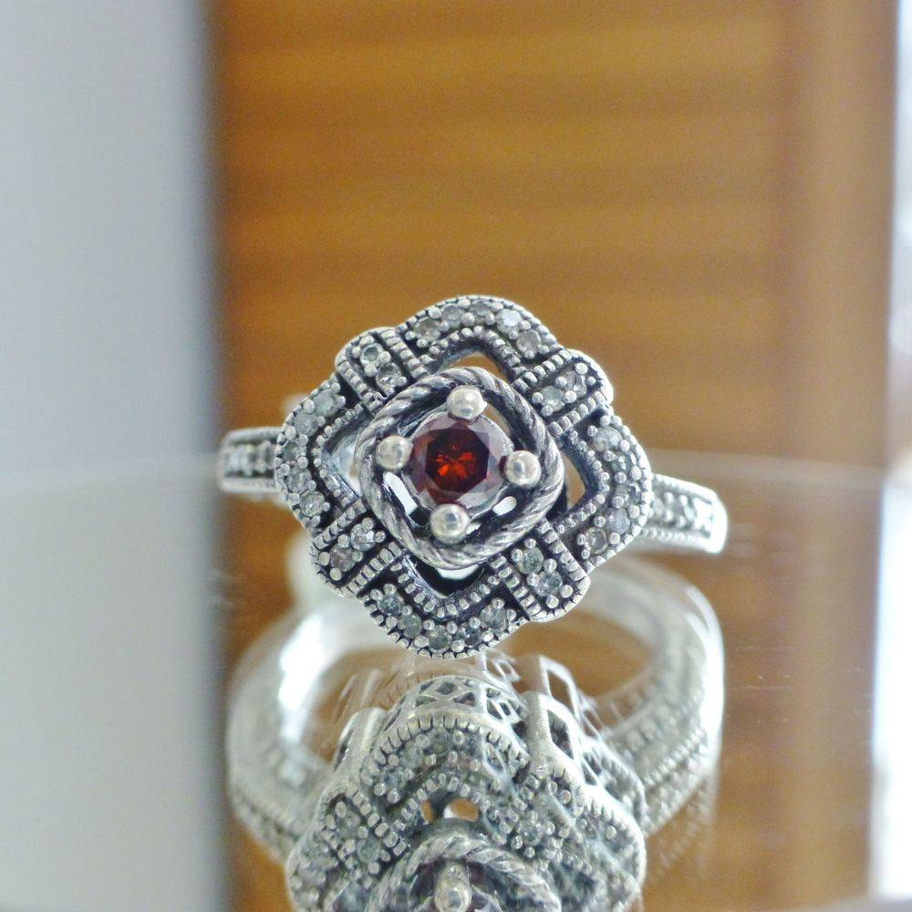 Upclose picture of garnet and cubic zirconia sterling silver ring