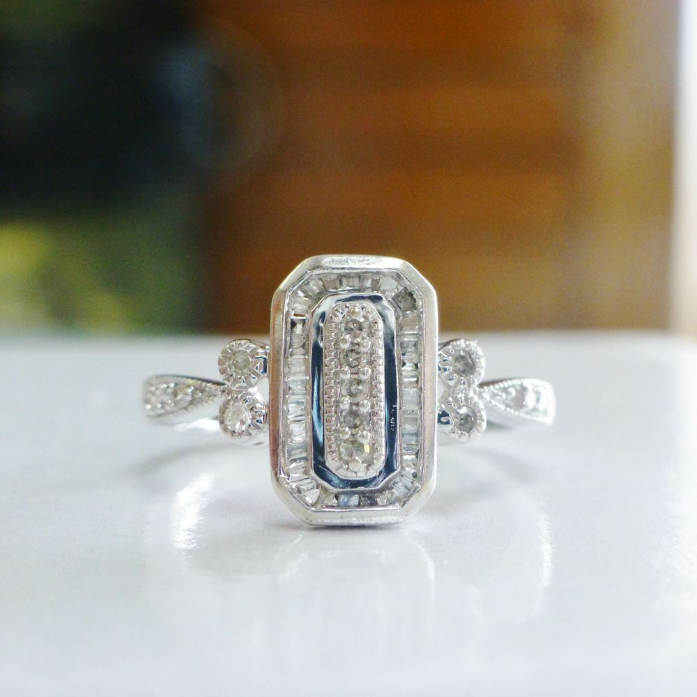Upclose picture of a white gold rectangular diamond starburst ring