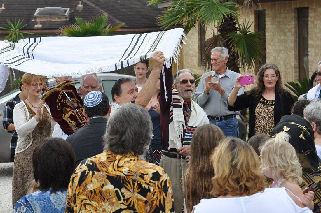 dancing around with a Torah and Tallit