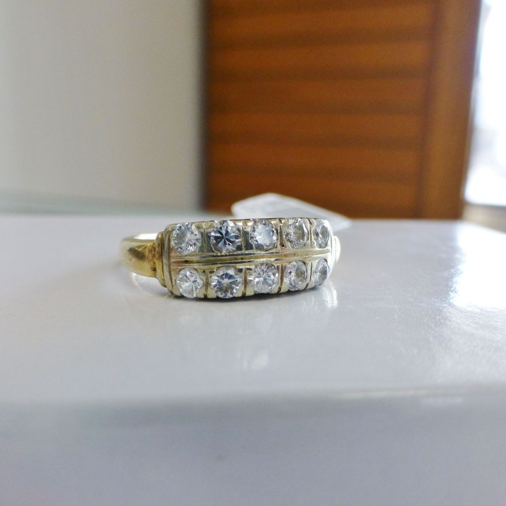 Closeup Picture of a round diamond double row antique ladies wedding band in white and yellow gold