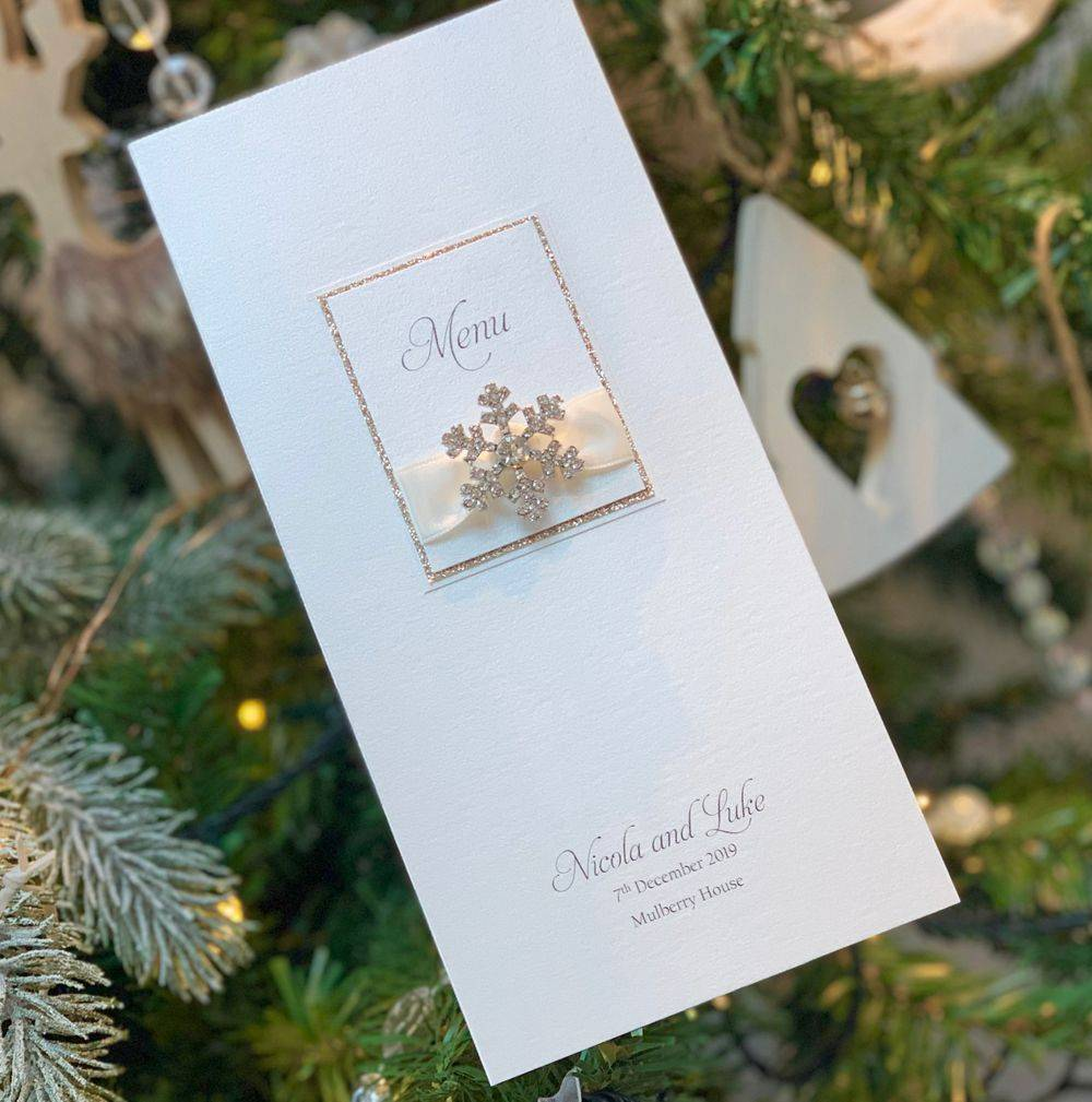 Christmas wedding menu with crystal snowflake and ivory and champagne gold glitter