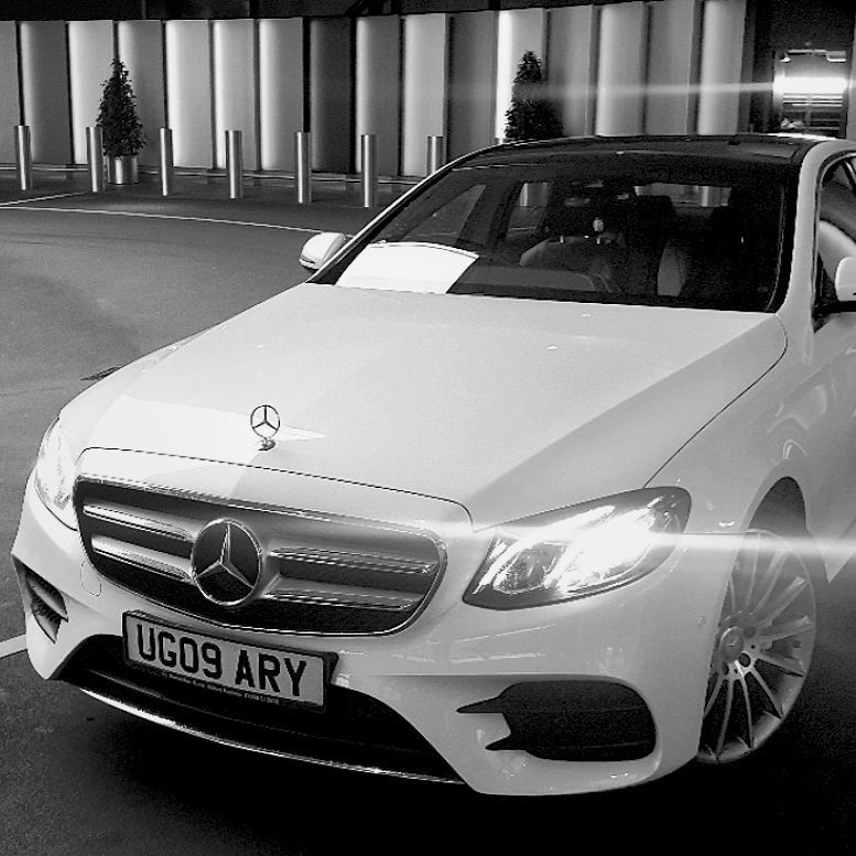 white mercedes on an airport transfer