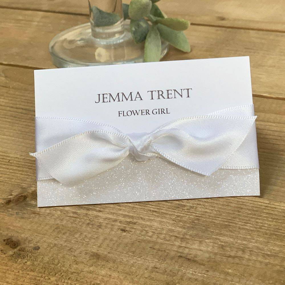 White wedding place name card with glitter and ribbon