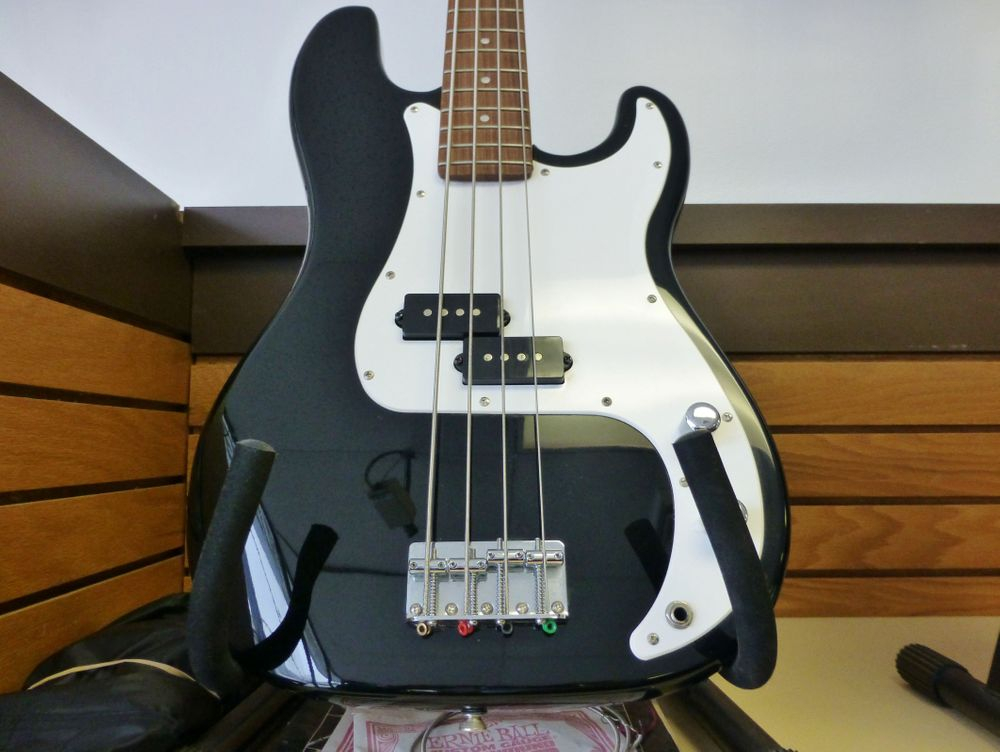 closeup picture of a black and white Fender P Bass Guitar