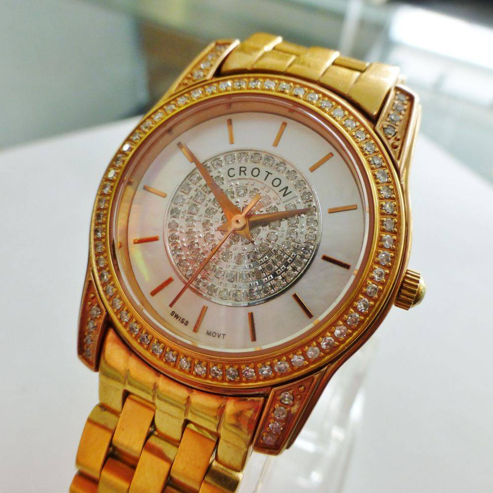 Rose gold tone mother of pearl dial ladies watch
