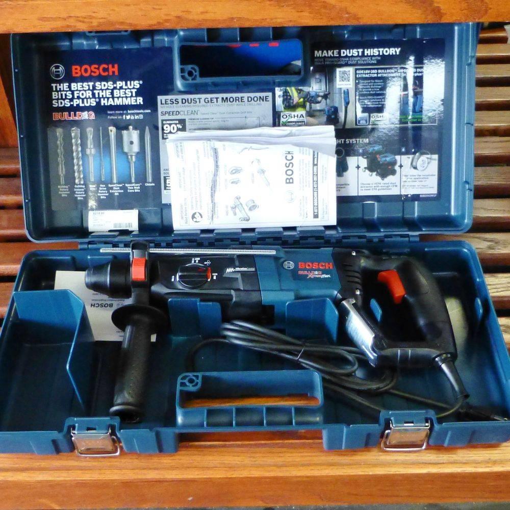 blue Bosch hammer drill in a hard case sitting on wooden shelf