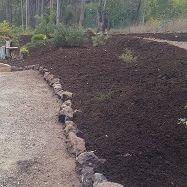 Garden bed at Pies Creek with freshly installed mulch by Gympie Home Handyman, Gardening & Maintenance Services