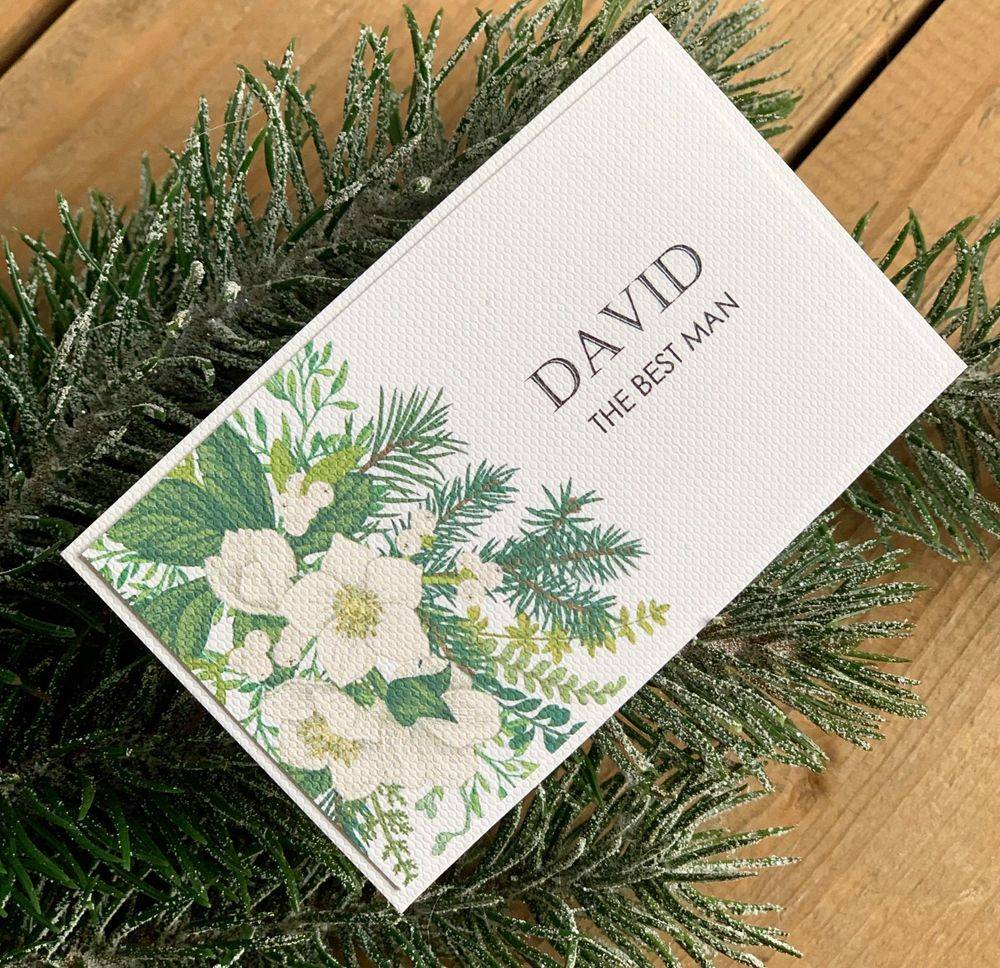 Winter, christmas wedding place name with winter flowers and mistleote