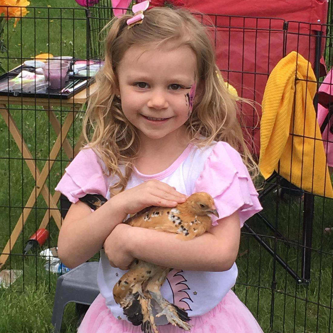 Girl and chicken
